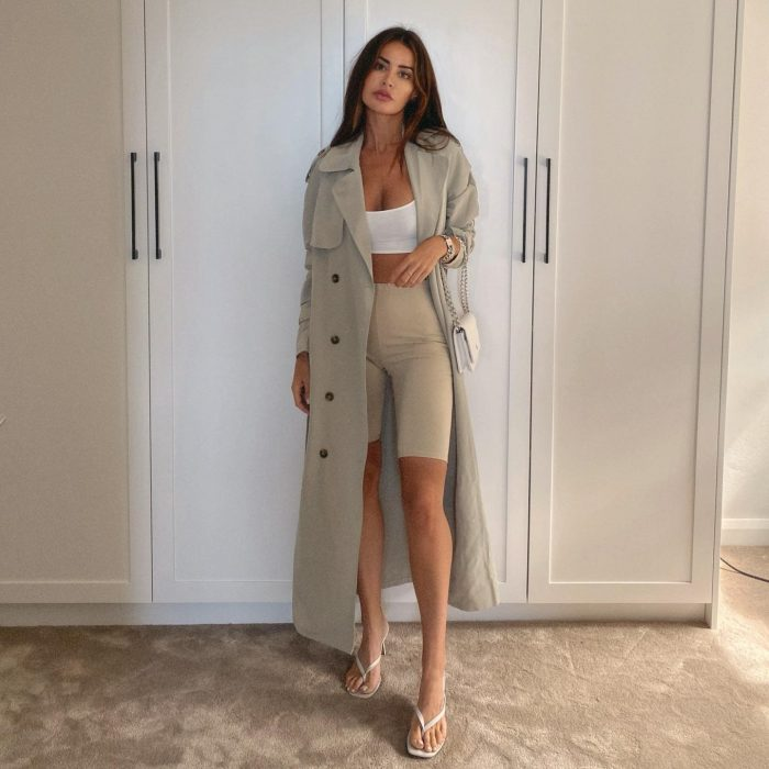 @emmaroseofficial wearing PrettyLittleThing Pale Khaki Trench Coat White Slinky Racer Back Crop Top